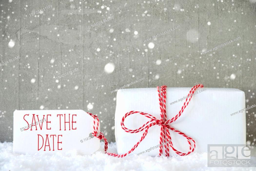 Stock Photo: Label With English Text Save The Date. One Christmas Present On Snow. Cement Wall As Background With Snowflakes. Modern And Urban Style.