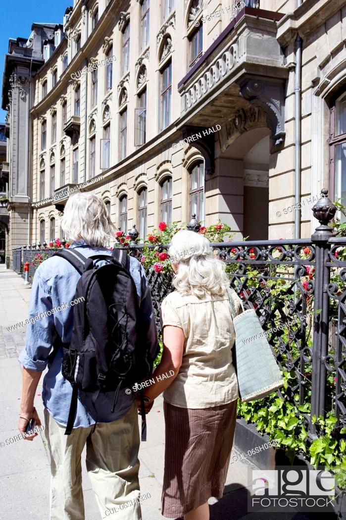 Stock Photo: Couple walking away from camera.