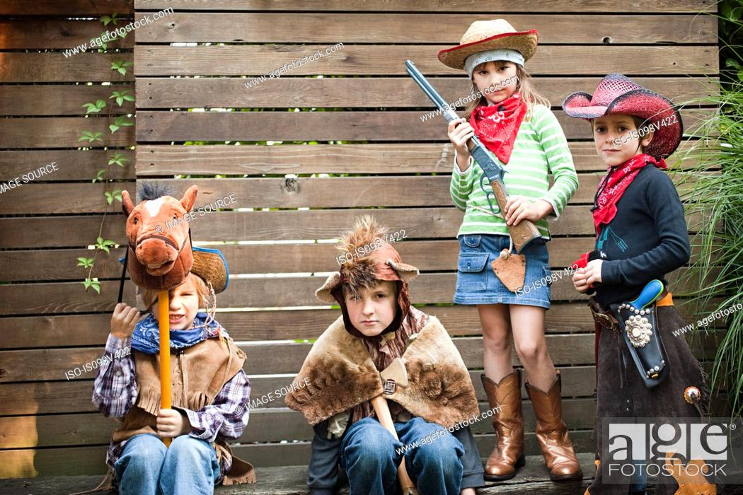 Stock Photo: Children dressed up as cowgirl, bear and cowboys.