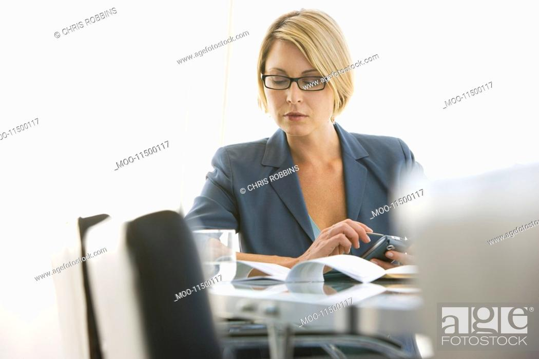Stock Photo: Business woman working in conference room.
