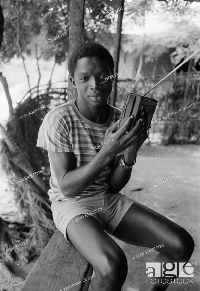 Stock Photo: Young man listening to the radio Guinea-Bissau 1984.