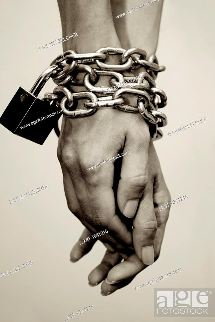 Stock Photo: Hands Chained at the Wrists.