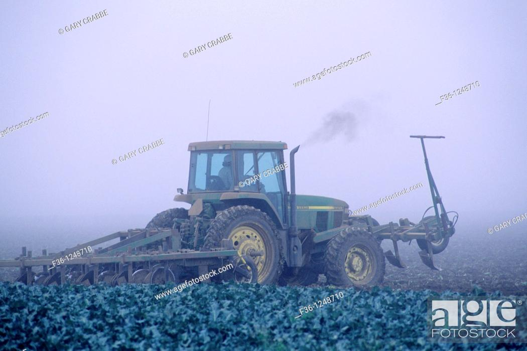 Stock Photo: Farm plow tractor in fog shrouded field, near Guadalupe, Santa Maria Valley, San Luis Obispo County, CALIFORNIA.