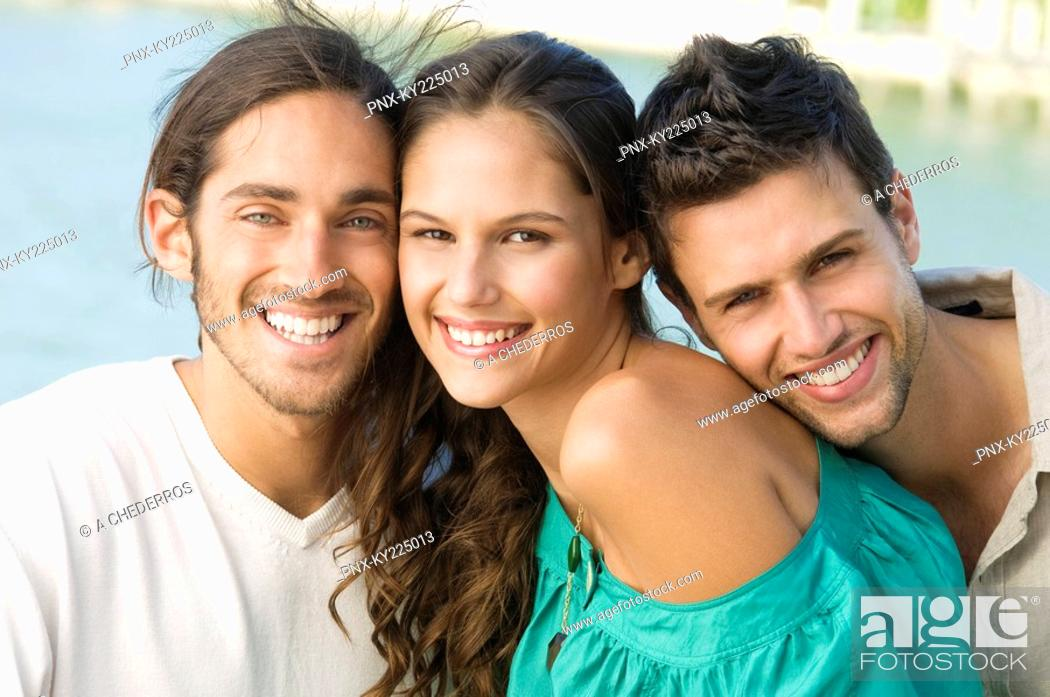 Stock Photo: Three friends smiling.