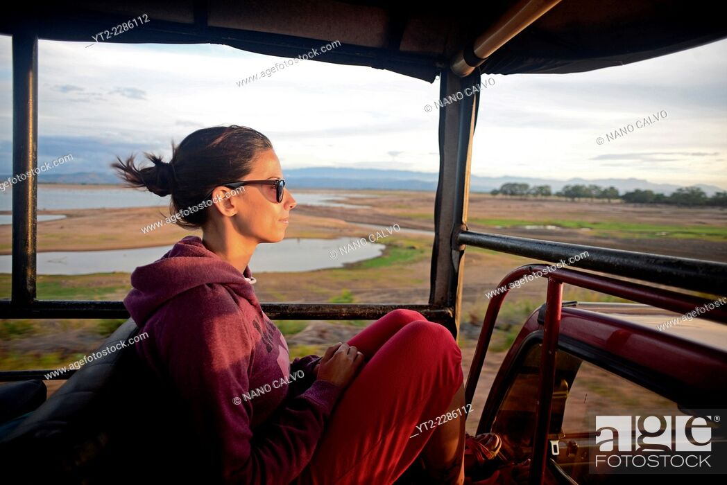 Stock Photo: Young woman on safari jeep at Udawalawe National Park, Sri Lanka.