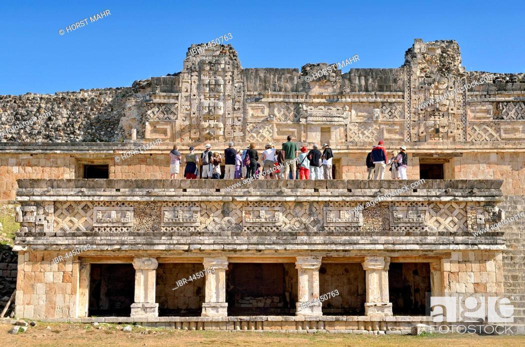Stock Photo: Tourists on Cuadrangulo de las Monjas, Nun's Quadrangle, ancient Mayan city of Uxmal, Yucatan, Mexico.