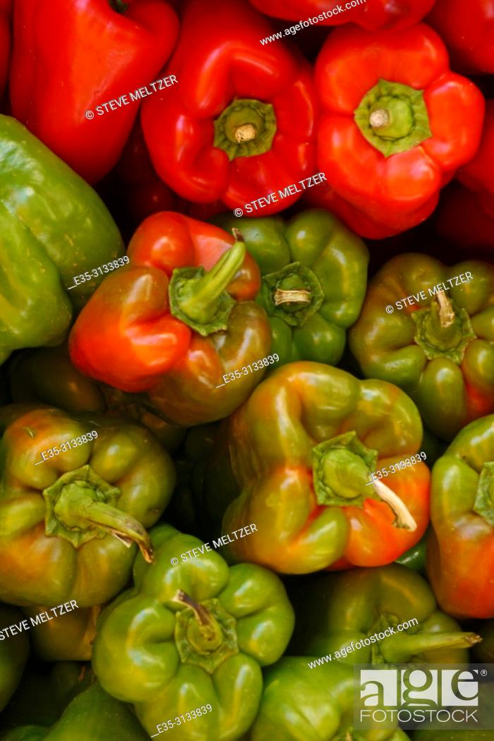Stock Photo: Piles of red and green peppers at a fruit and vegetable stand in Pezenas, France.