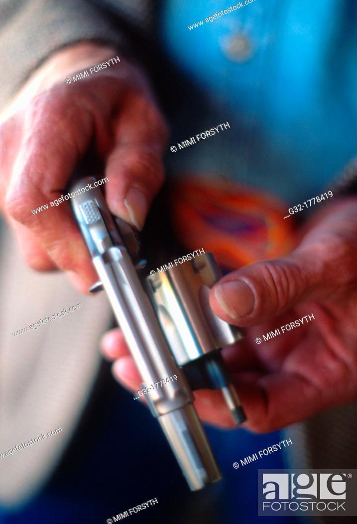 Stock Photo: Man opens 38 pistol.