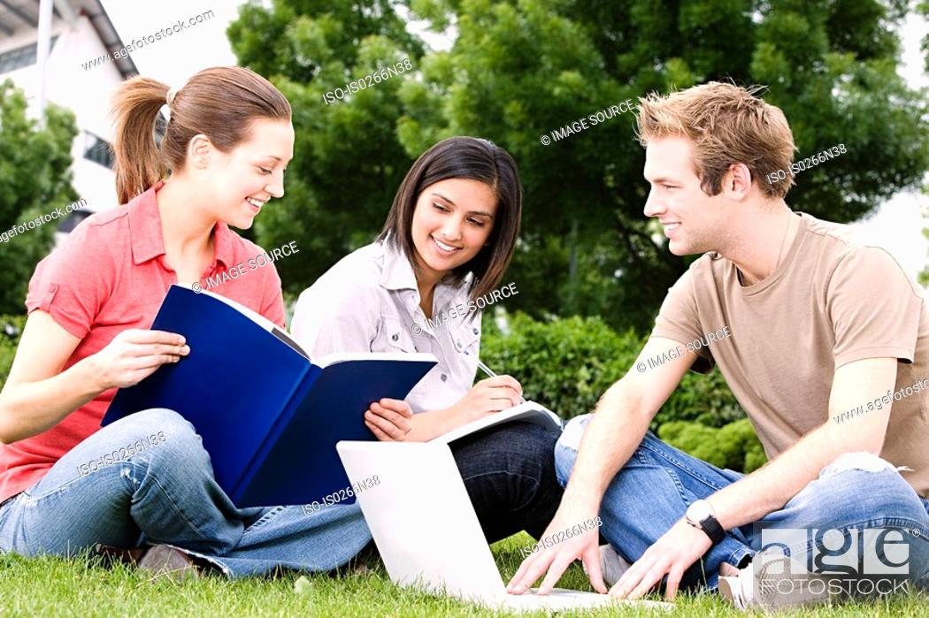 Stock Photo: Students working outdoors.
