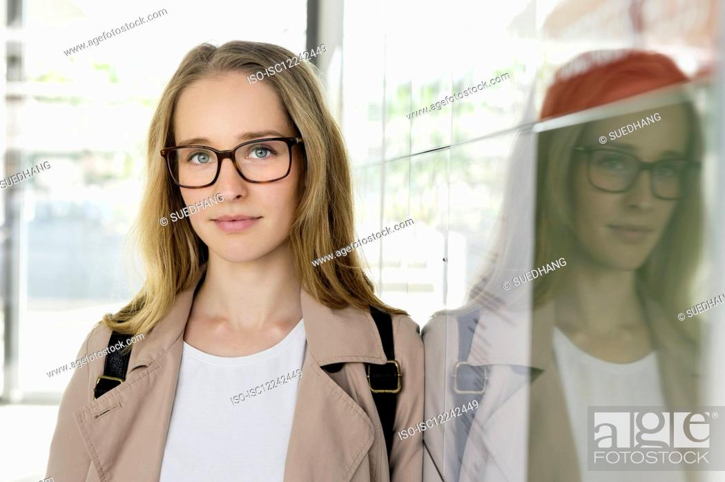 Stock Photo: Portrait of young blond businesswoman wearing glasses.