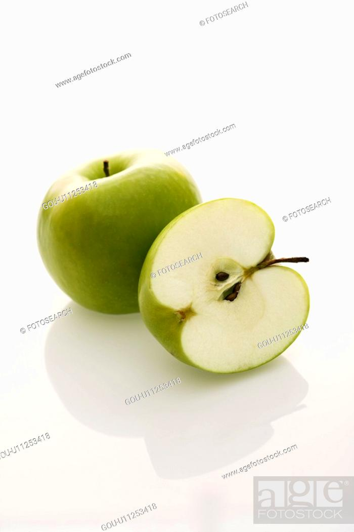 Stock Photo: Still life of whole and sliced green apples on white background.