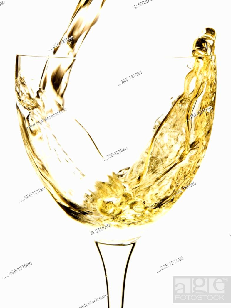 Stock Photo: pouring a glass of white wine.