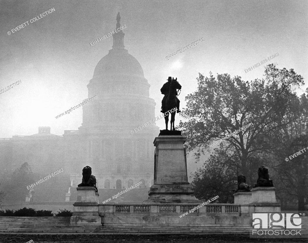 Stock Photo: U.S. Capitol on an atmospheric day, Nov. 14, 1953. The statue of Civil War General Ulysses S. Grant, 1922, is the second largest equestrian statue in the United.