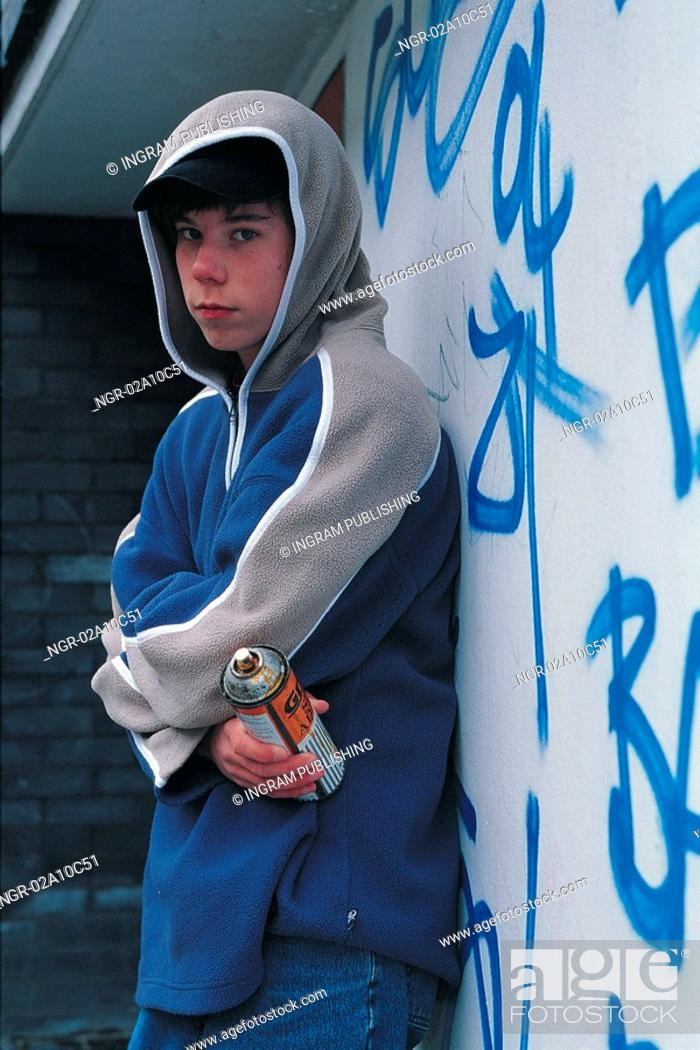 Stock Photo: young boy holding a spray paint can.