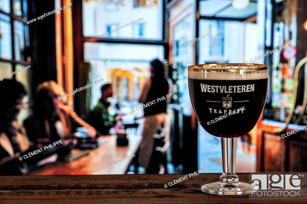 Stock Photo: Glass with trappist Westvleteren - best beer in the world, brewed in the Sint-Sixtusabdij / Abbey of Saint Sixtus - served in café in Belgium.