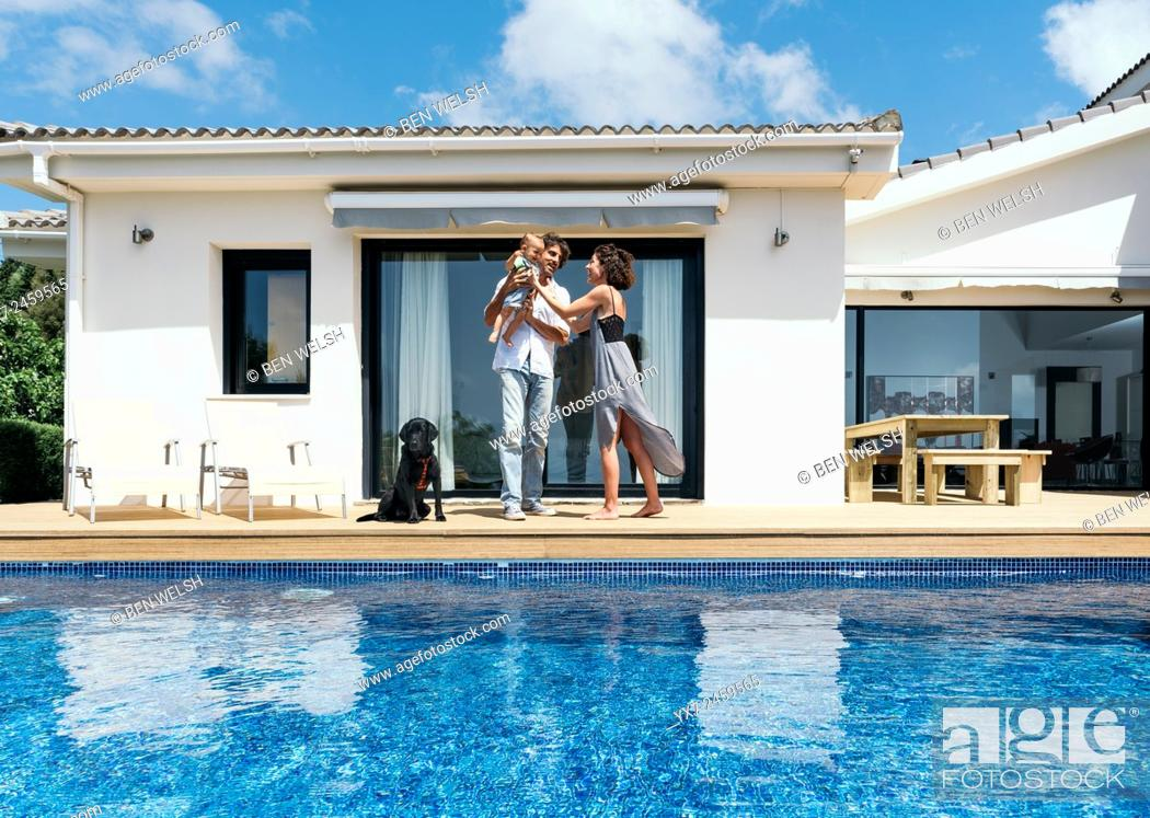 Stock Photo: Happy family on the terrace of there house.