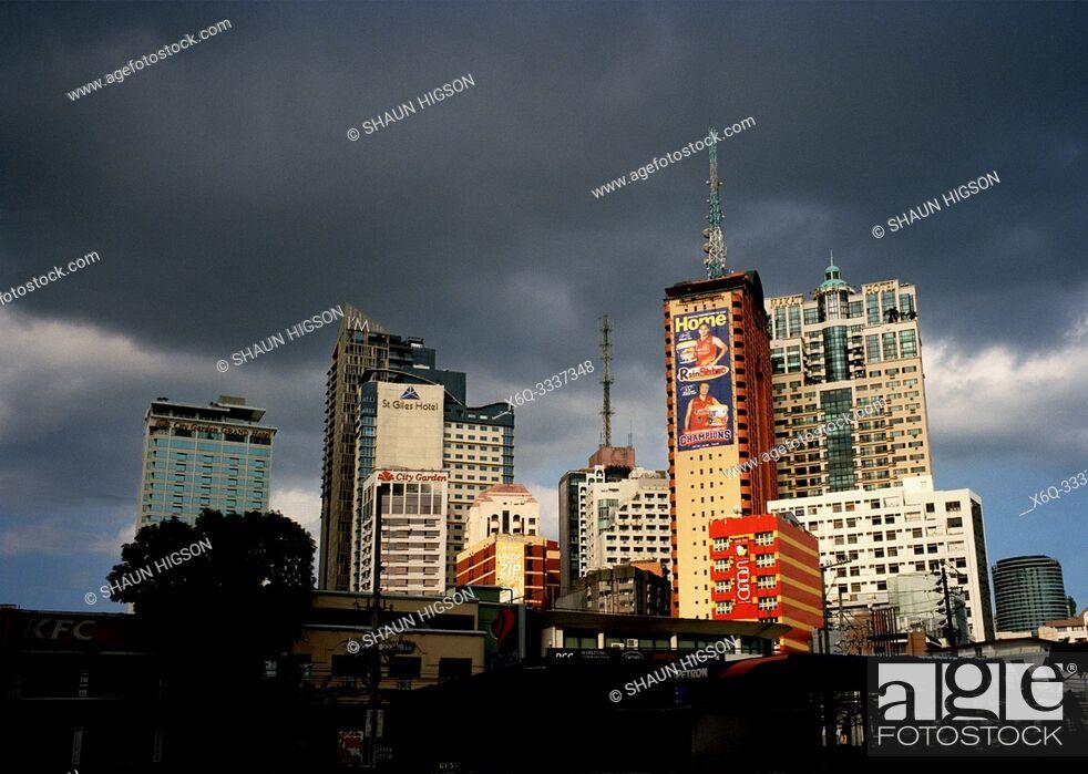 Stock Photo: Manila skyline in Makati in Manila in Luzon Metro Manila in the Philippines in Southeast Asia Far East.