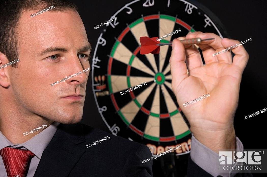 Stock Photo: Businessman playing darts.