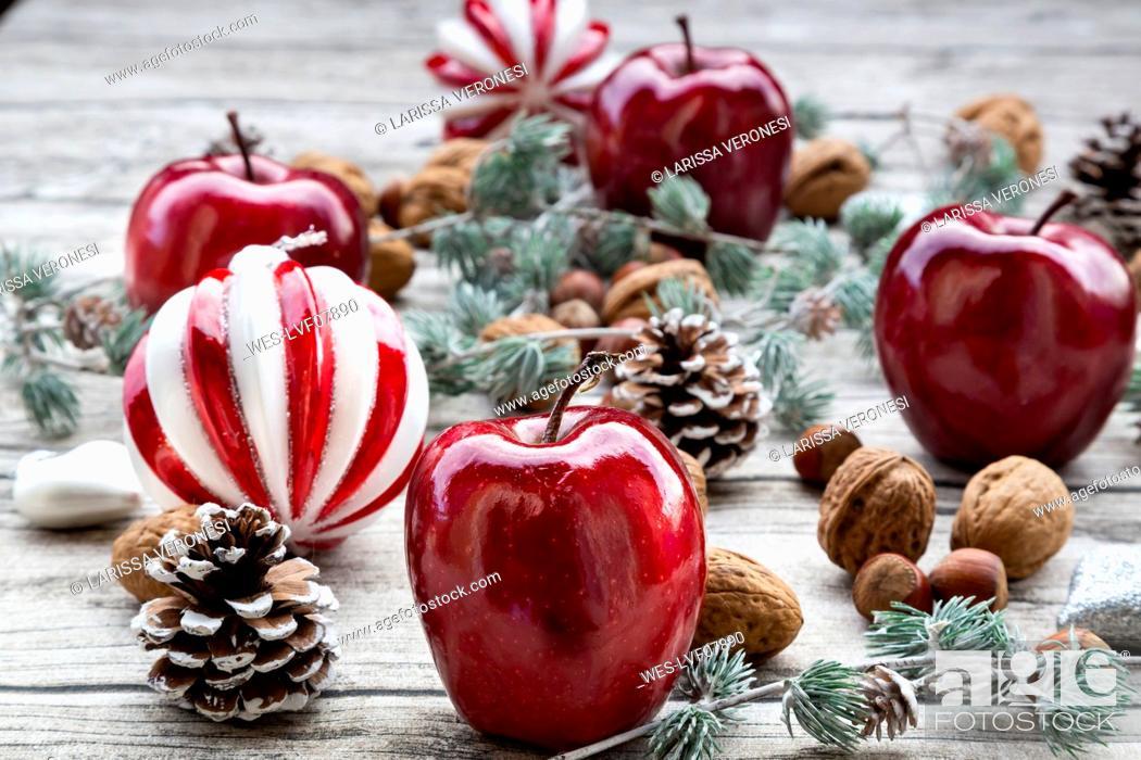 Stock Photo: Christmas apples, walnuts, hazelnuts and Christmas decoration on wood.