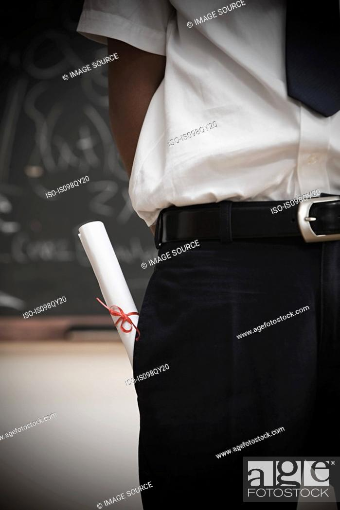 Stock Photo: Student with scroll in pocket.