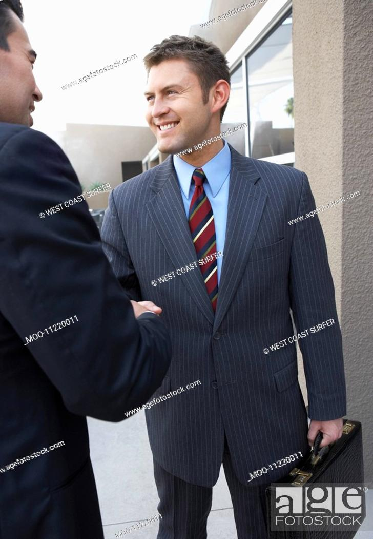 Stock Photo: Two Businessmen Shaking Hands outside office.
