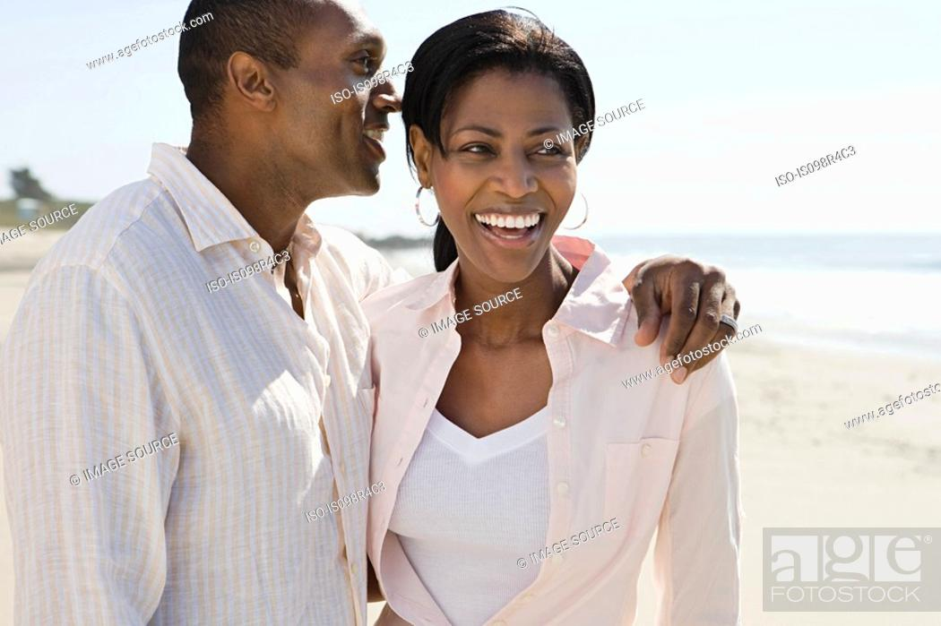 Stock Photo: Romantic couple on a beach.