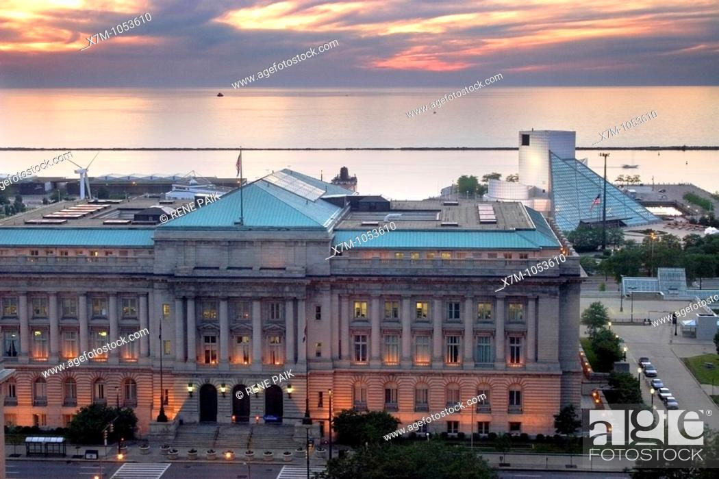 Stock Photo: Cleveland City Hall with the Rock and Roll Hall of Fame on Key Plaza and Lake Erie in the background.
