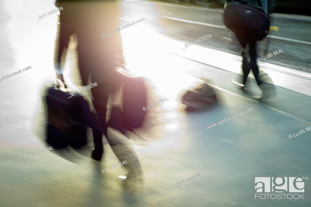 Stock Photo: backlit movement at the station.