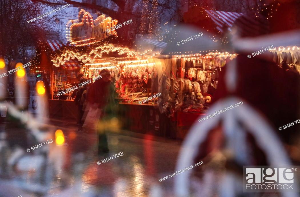 Stock Photo: (161222) -- BERLIN, Dec. 22, 2016 () -- People walk around in the reopened Christmas market at the Breitscheid Square in Berlin, capital of Germany, on Dec.