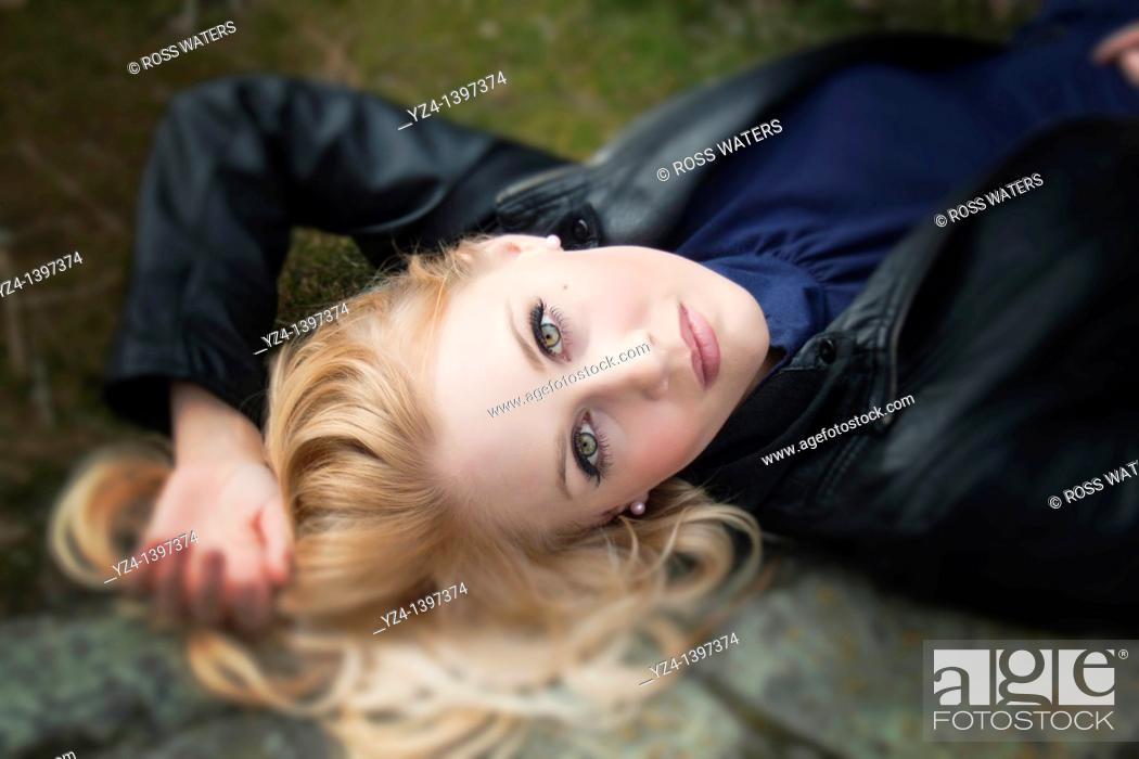Stock Photo: A young woman outdoors.