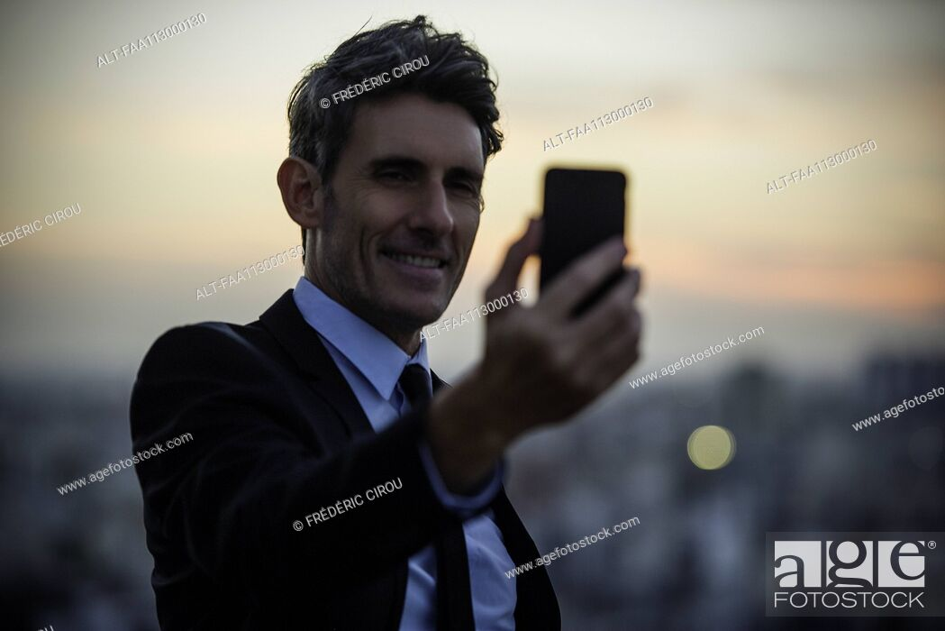 Stock Photo: Businessman taking selfie with mobile phone.