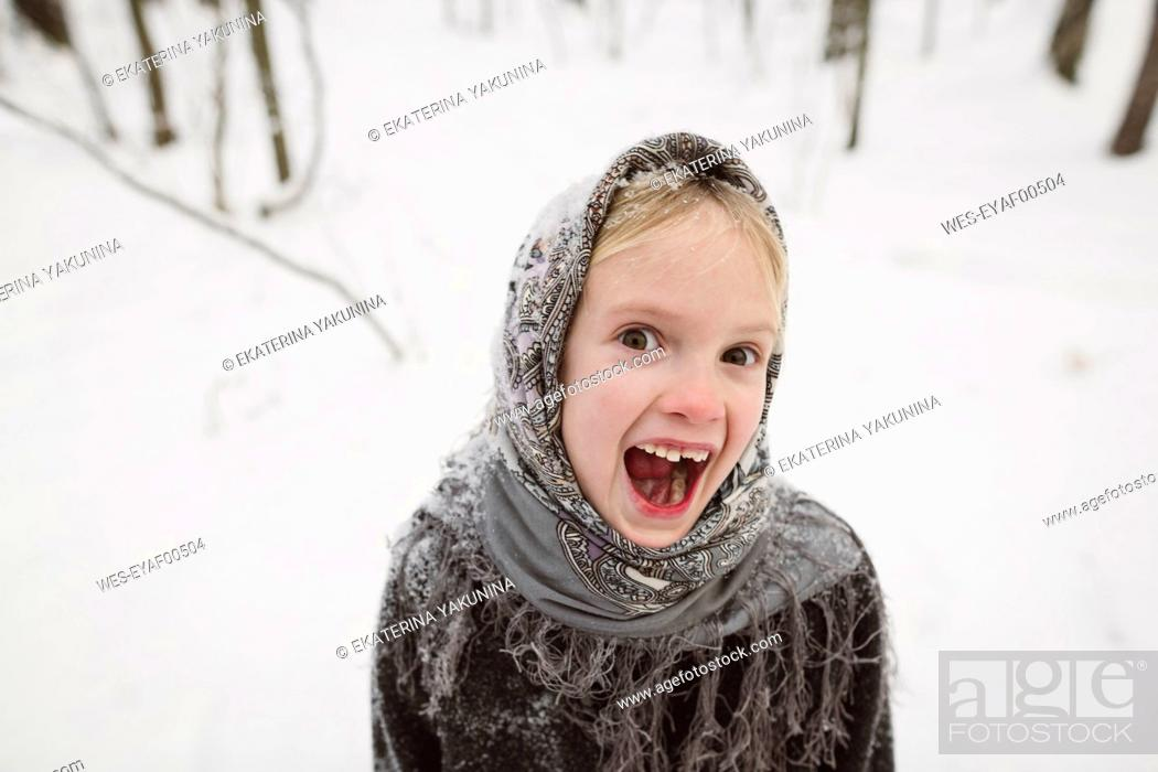 Photo de stock: Portrait of screaming little girl in winter forest.