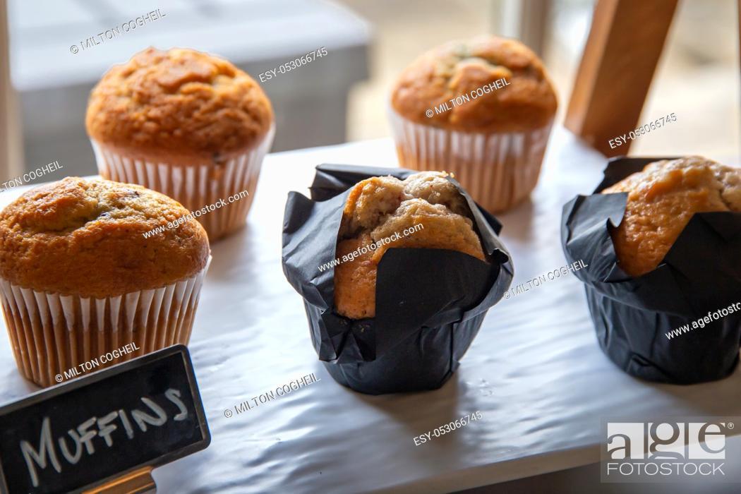 Stock Photo: Warm breakfast muffins on display.