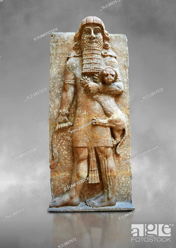 Stock Photo: Stone statue of a Hero holding a lion. From facade M of the palace courtyard , Inv AO 19861 from Dur Sharrukin the palace of Assyrian king Sargon II at.