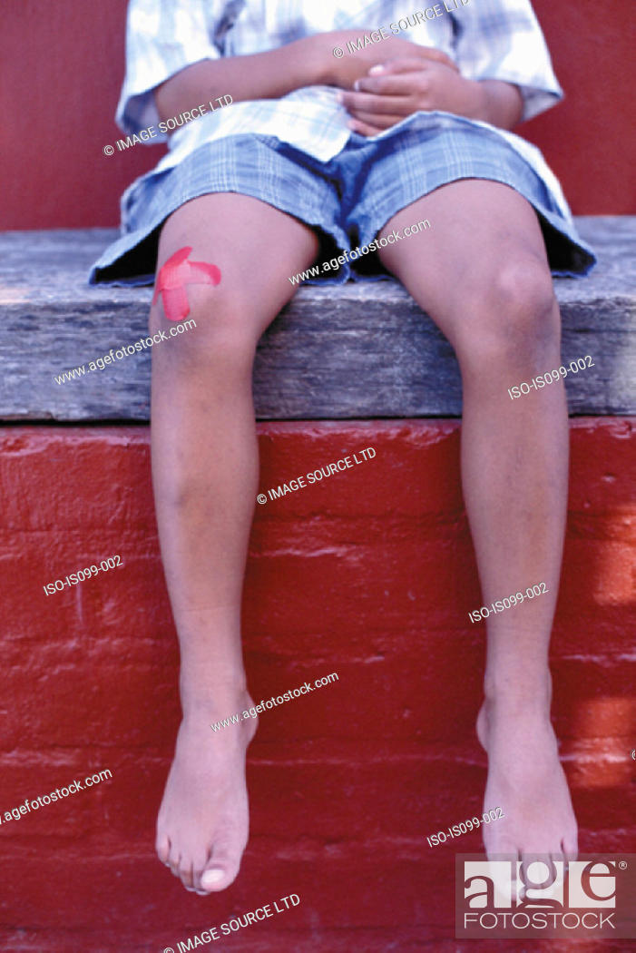 Stock Photo: Boy with injured knee.