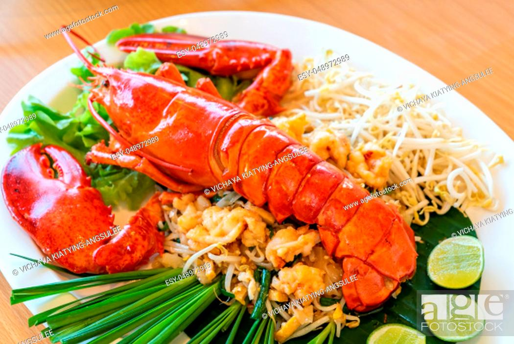 Stock Photo: Lobster Pad thai, stir fried Thai rice noodle pasta with whole lobster and lobster meat.