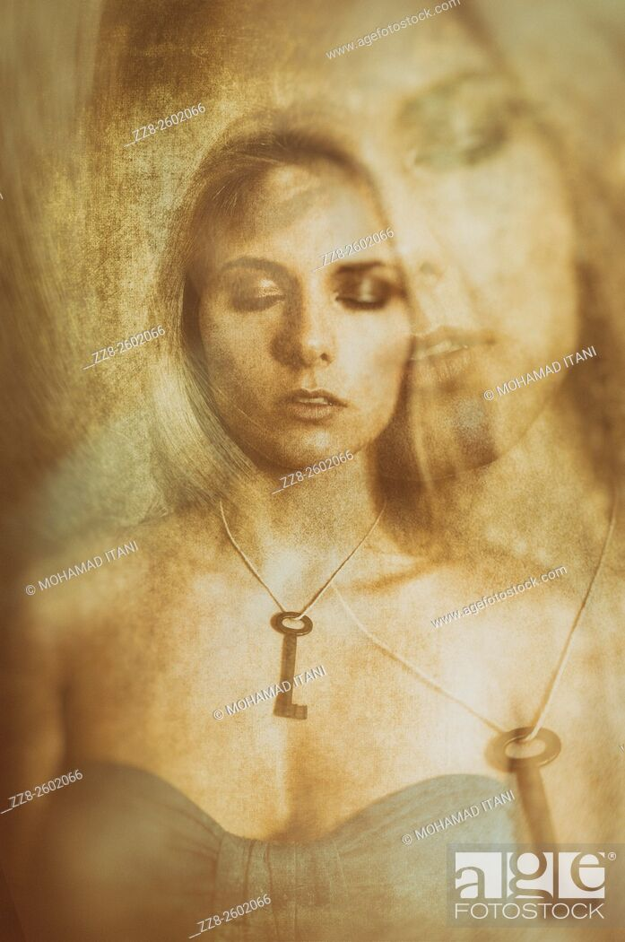 Stock Photo: Double exposure portrait of a young woman wearing a key necklace with her eyes closed.