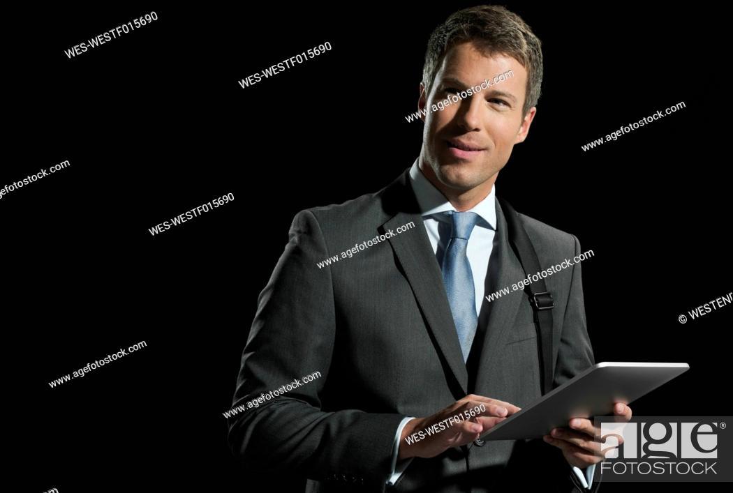 Stock Photo: Mid adult man using digital tablet.
