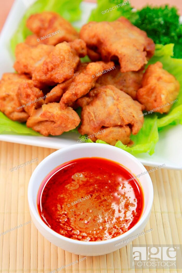 Imagen: Chinese Spicy Sauce with Fried Chickens.