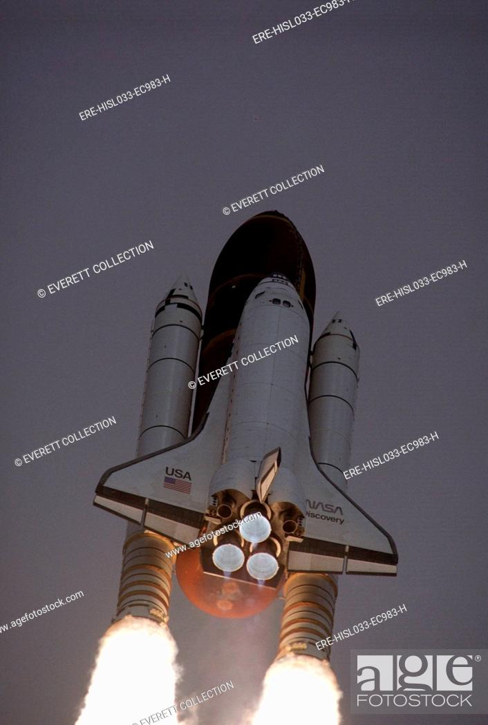 Stock Photo: Space Shuttle Discovery launched with Hubble Space Telescope in its cargo bay. April 24, 1990.