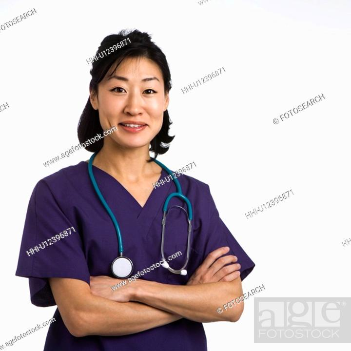 Stock Photo: Asian woman doctor half length portrait against white background.