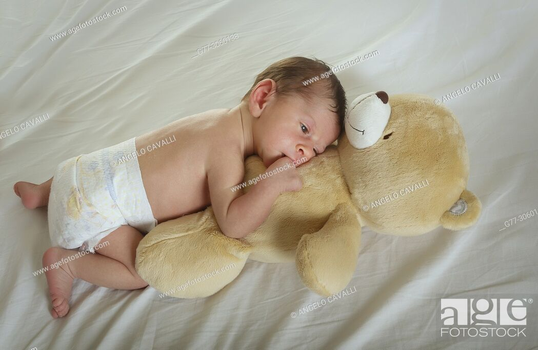 Stock Photo: newborn baby with teddy bear.
