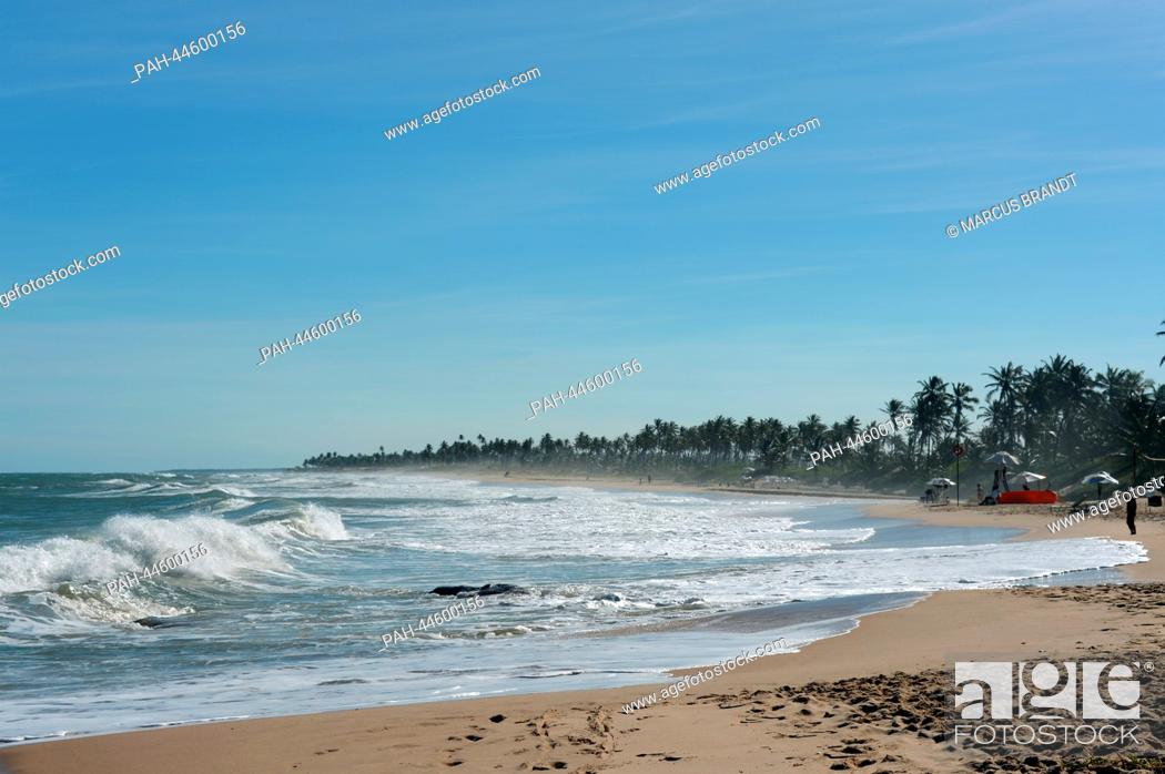 Stock Photo: Waves gush onto the beach in Costa do Sauipe, Brazil, 03 December 2013. The final draw for the preliminary round groups of the 2014 FIFA world cup Brazil will.
