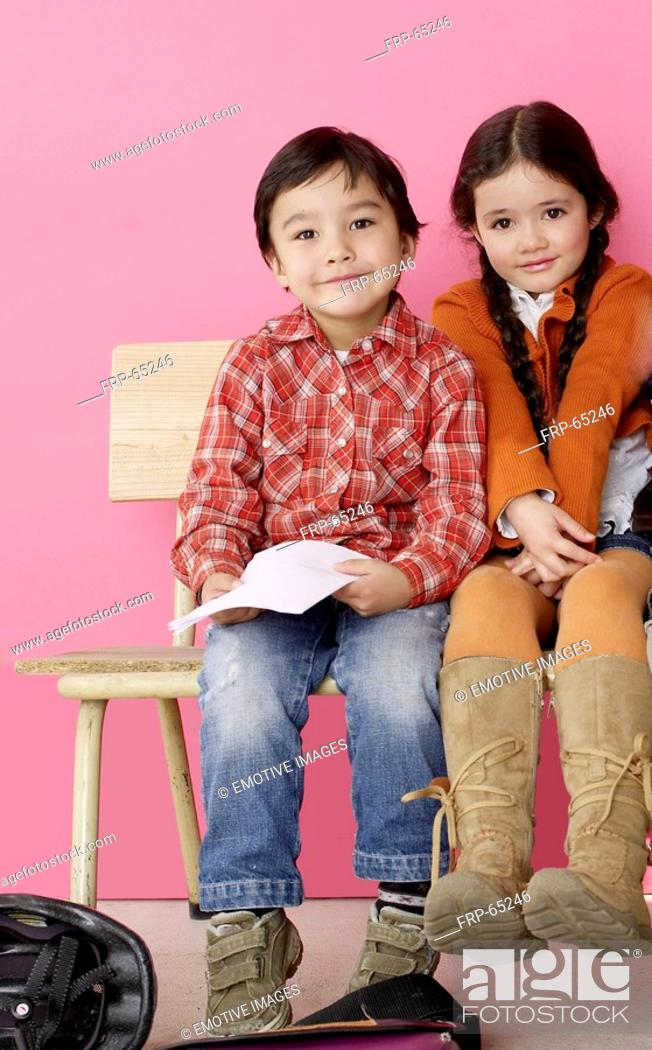 Stock Photo: Boy and girl sitting on a bench.