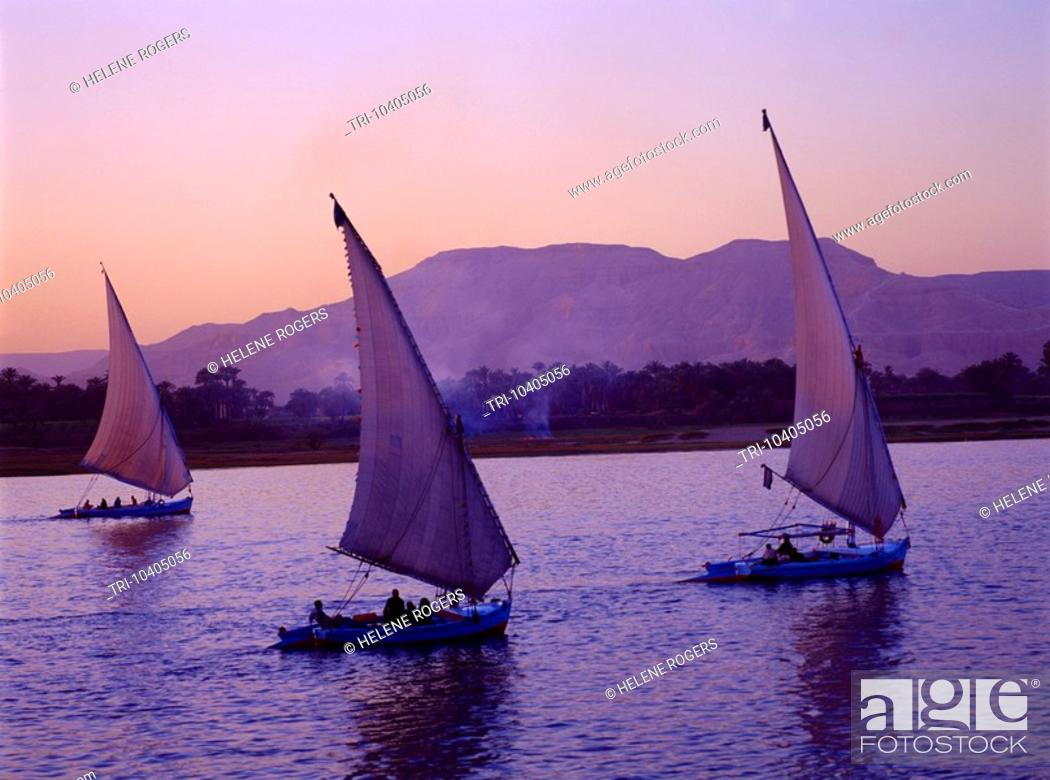 Stock Photo: Luxor Egypt Feluccas On The Nile Sunset.