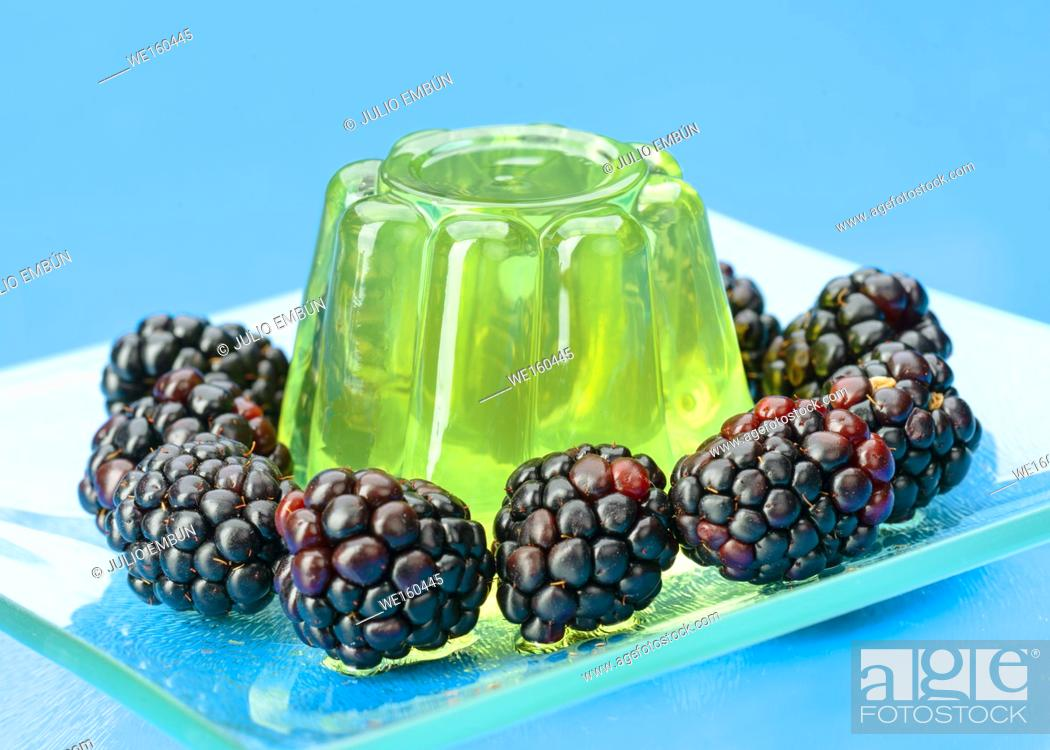 Photo de stock: colored gelatins on blue background.