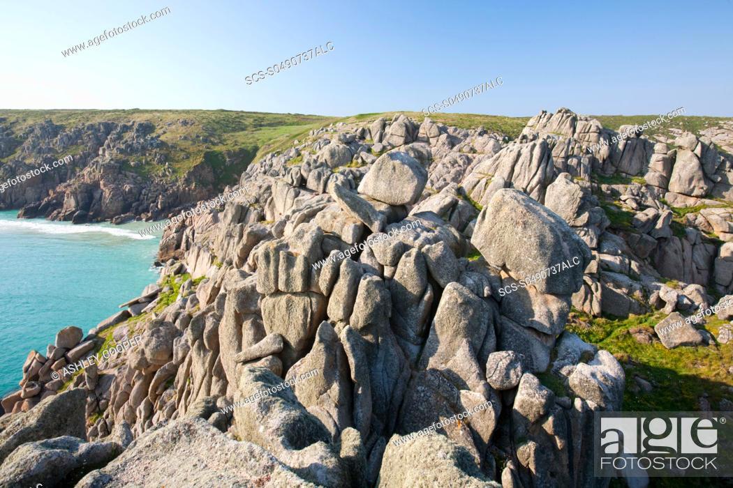 Stock Photo: Granite sea cliffs at logan rock Headland in Porthcurno, Cornwall, UK.