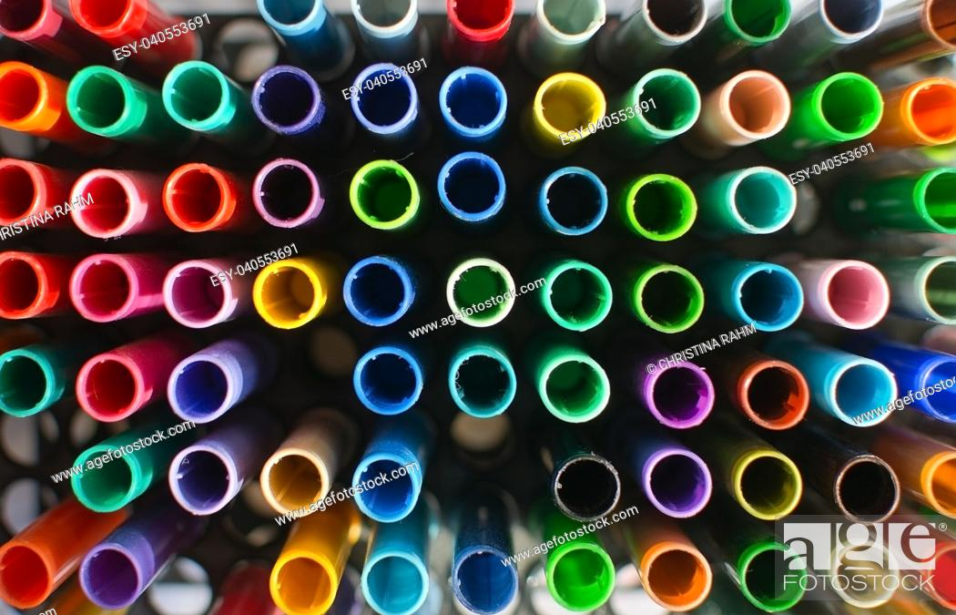 Stock Photo: Artists tools coloring pens in many shades seen from above.