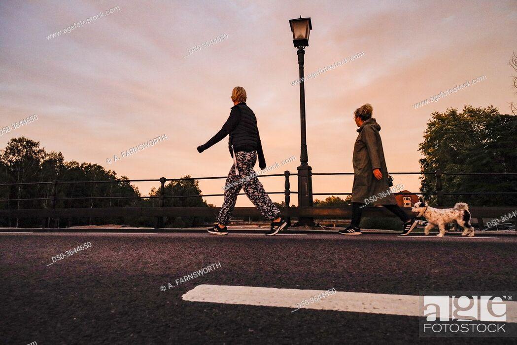 Photo de stock: Karlstad, Sweden Pedestrians on the old stone bridge, or Gamla Stenbron.