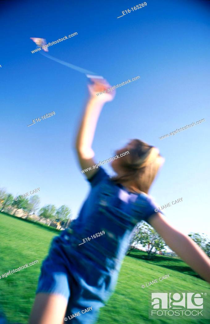 Stock Photo: Child flying kite.